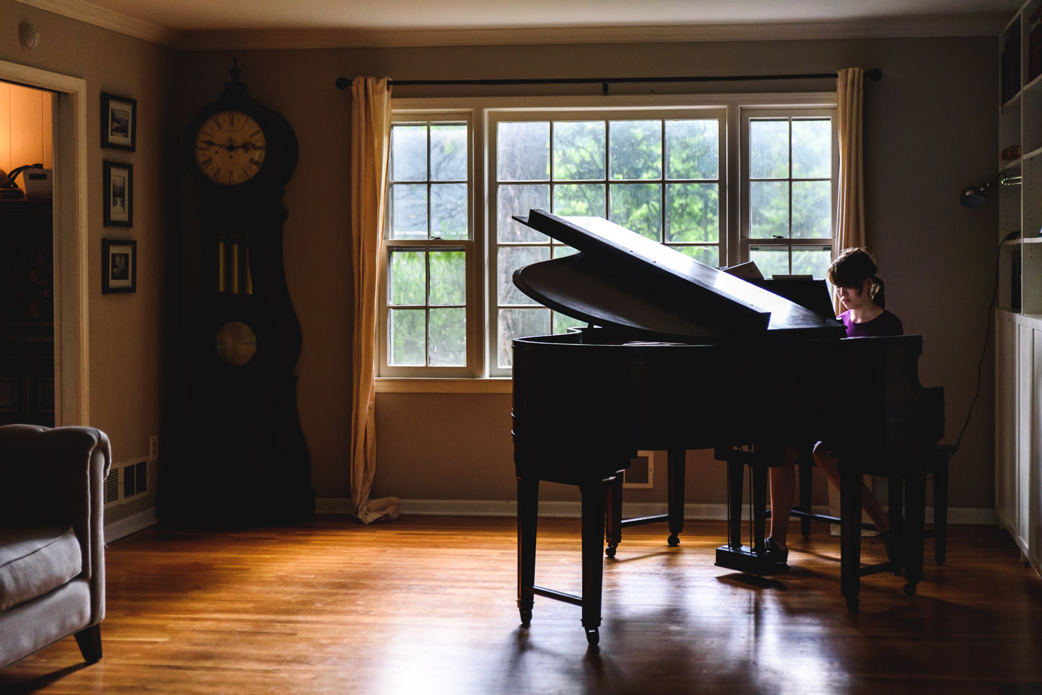 A teenager plays piano.