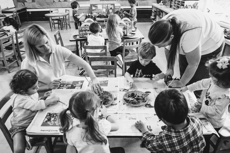 Preschoolers do a project at Garden City Nursery School.