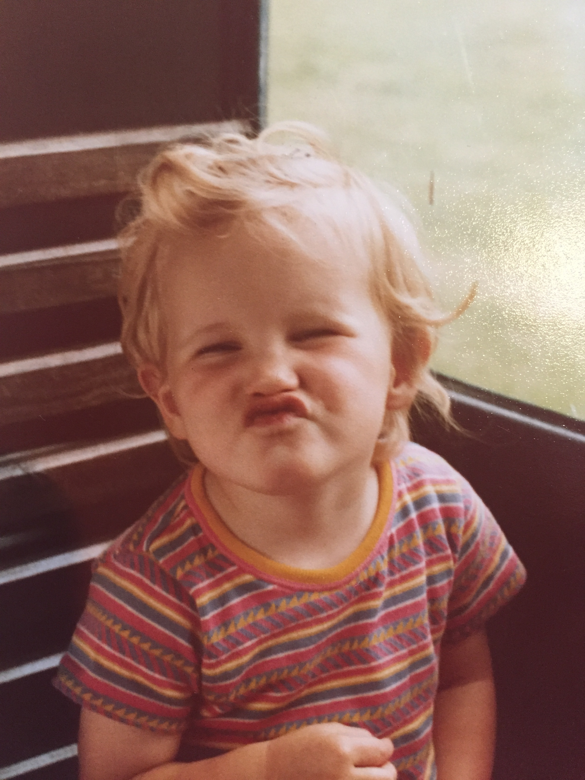A young girl making a funny face.