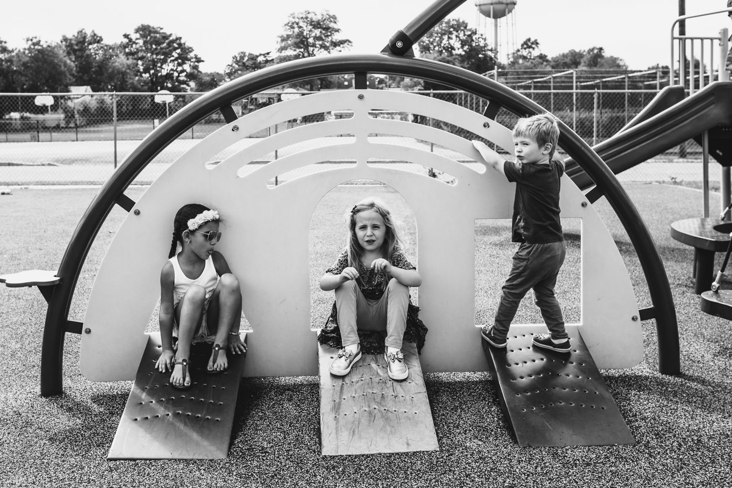 Some children play on a play structure after school.