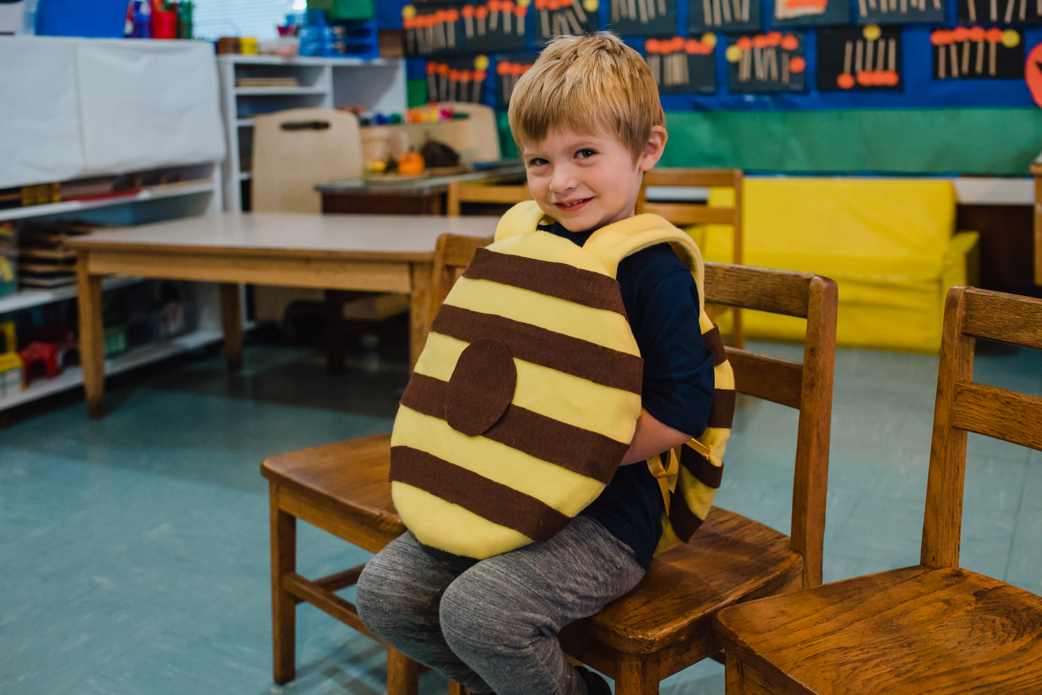 A little boy dresses as a fudge striped cookie for Halloween.