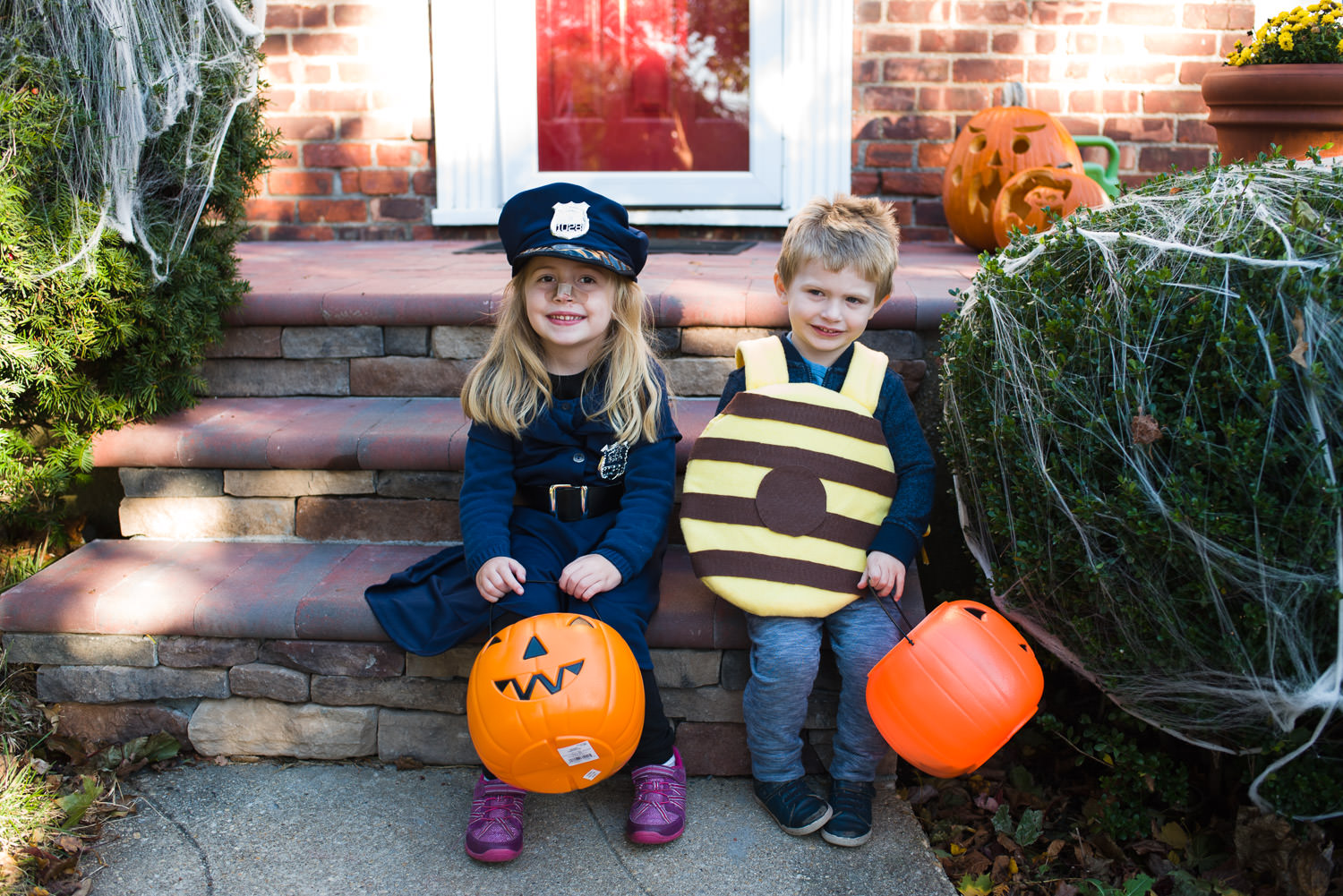 Two children dressed in costumes on Halloween.