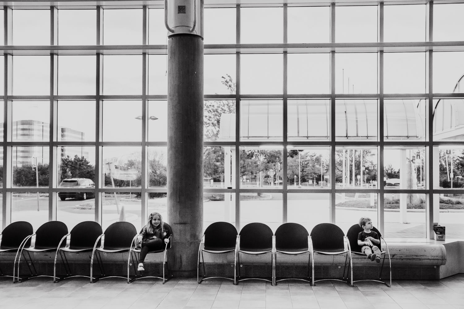 Two children sit in the lobby of the Cradle of Aviation.