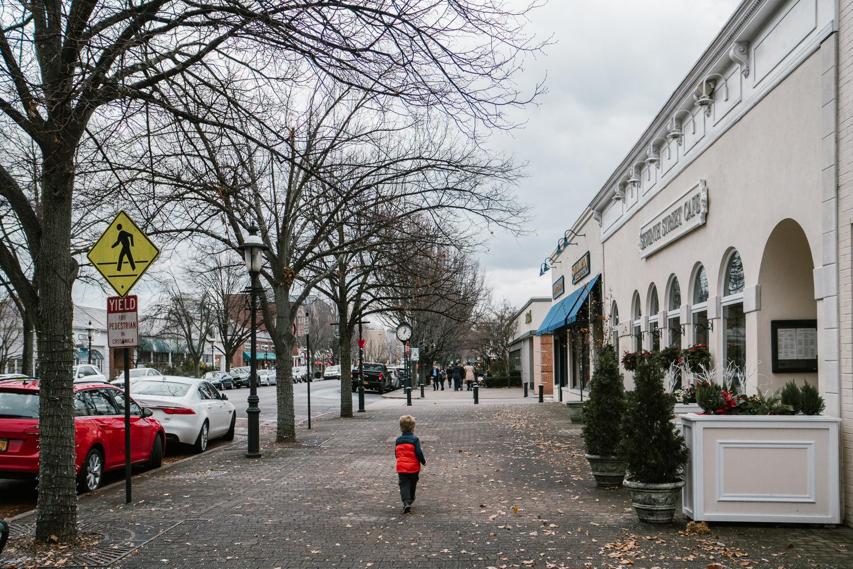 A little boy walks down 7th Street in Garden City.
