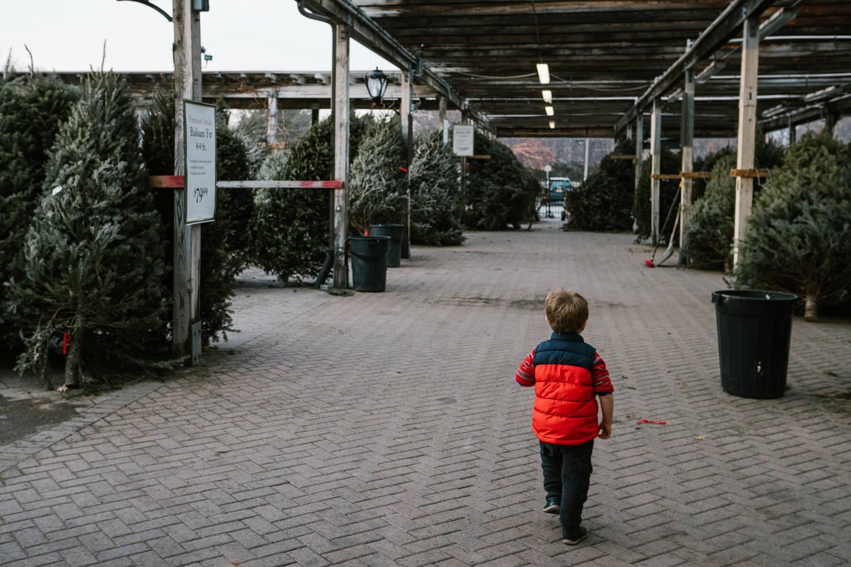 A little boy runs through the aisles at Hicks Nursery.