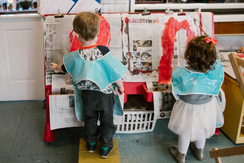 Kids paint at nursery school.