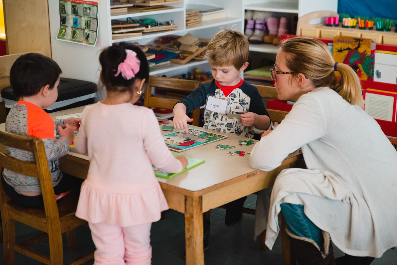 Children work on puzzles at nursery school.