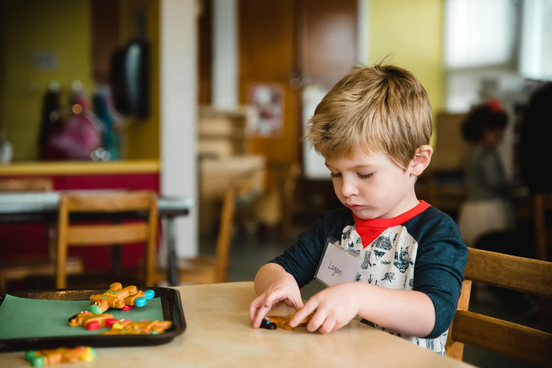 A boy does an activity at nursery school.