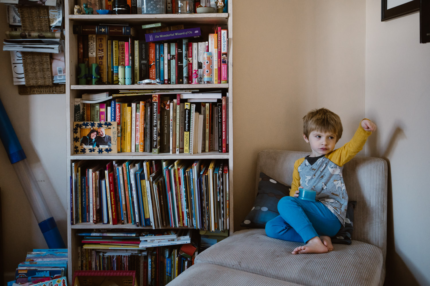A little boy sits in his living room.
