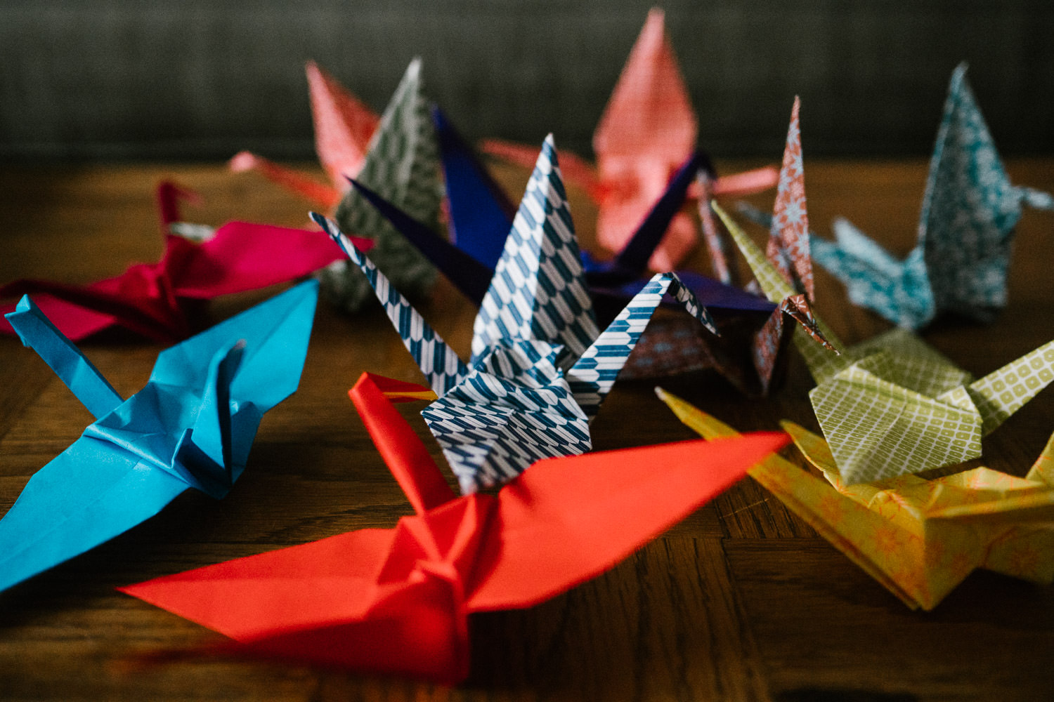 Origami cranes lie on a table.