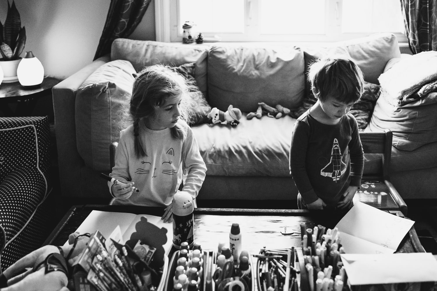 Children color at their coffee table at breakfast time.