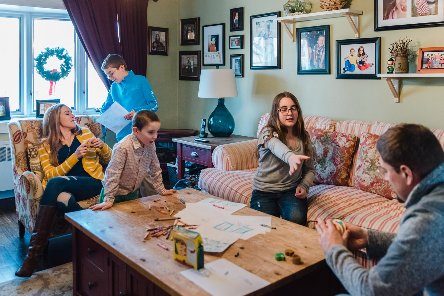 A family hangs out in their living room.