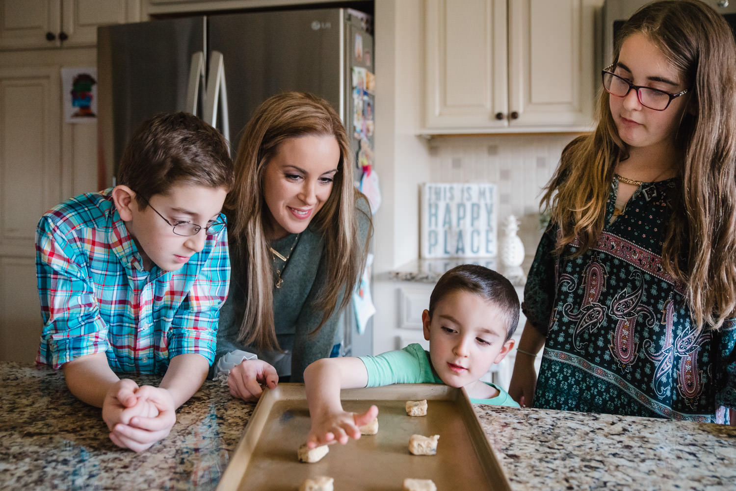 A family bakes cookies together.