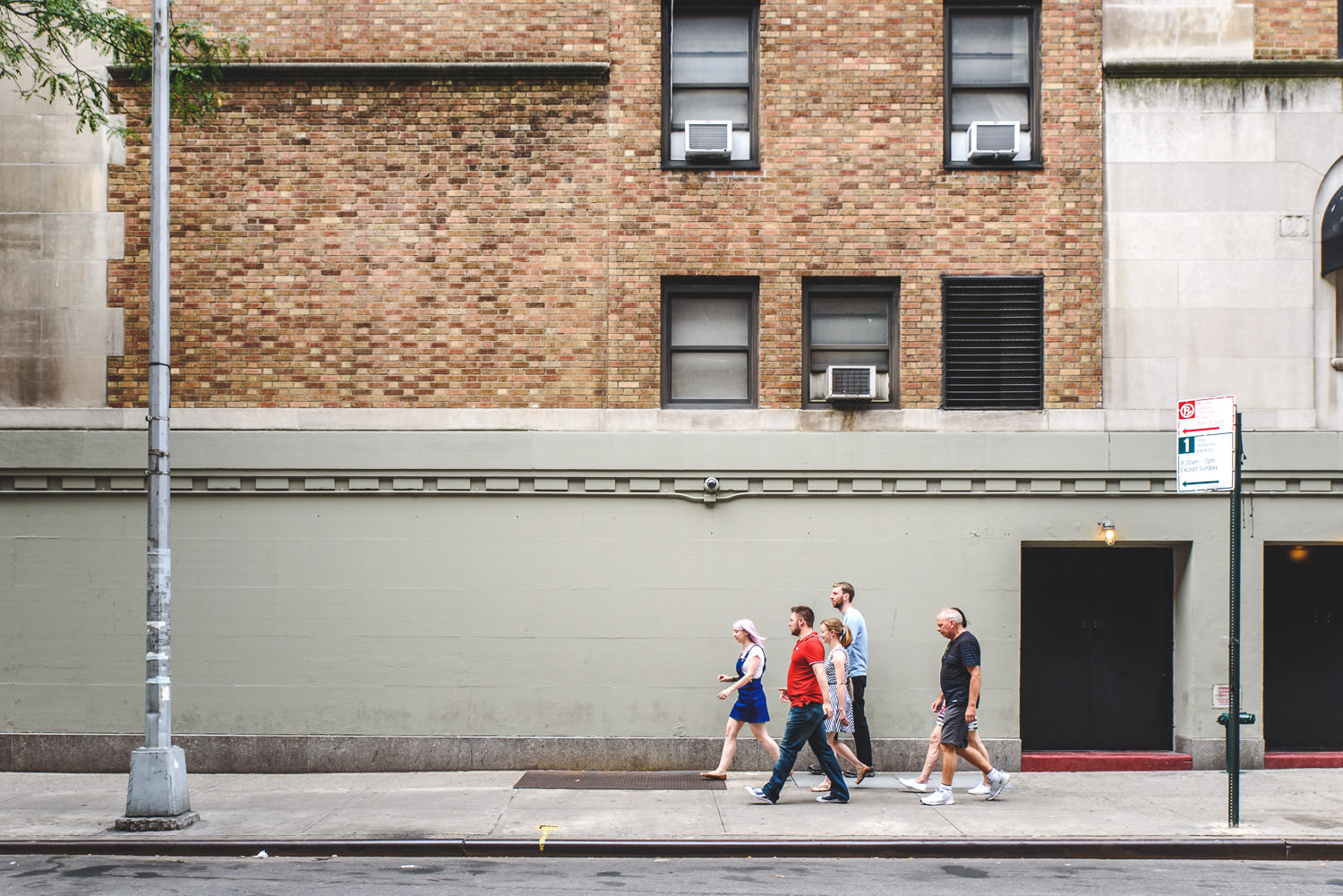 A family walks down the street in Manhattan.