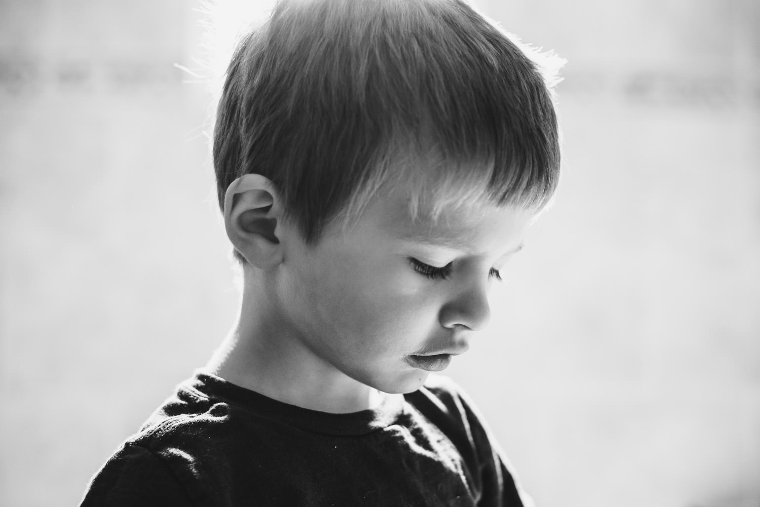 A portrait of a little boy in black and white.