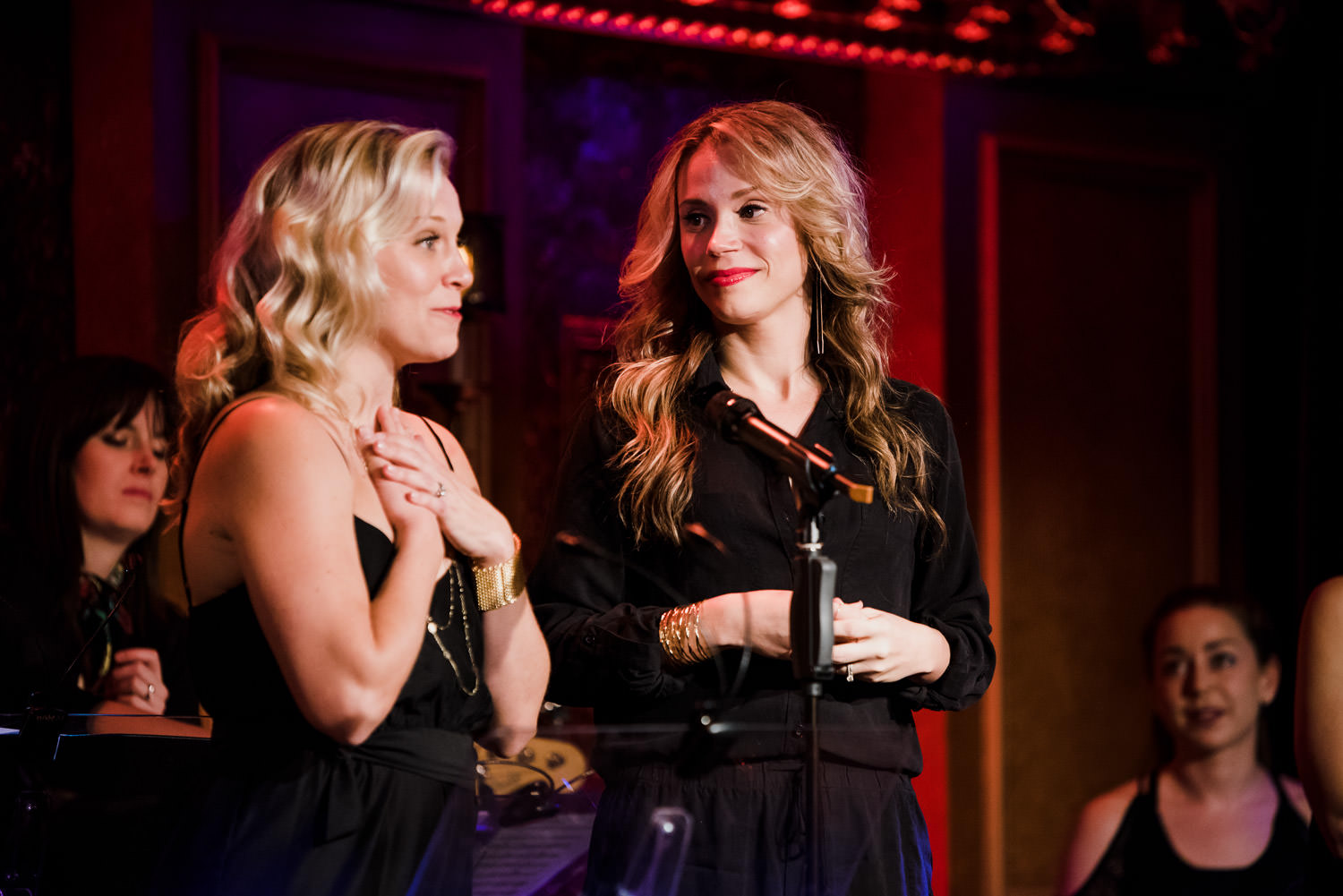 Cara Cooper and Jessica Rush speak to the crowd at 54 Below.