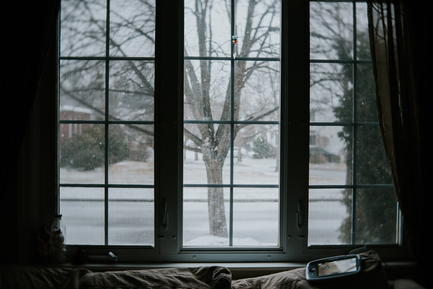 A snowy day outside the window.