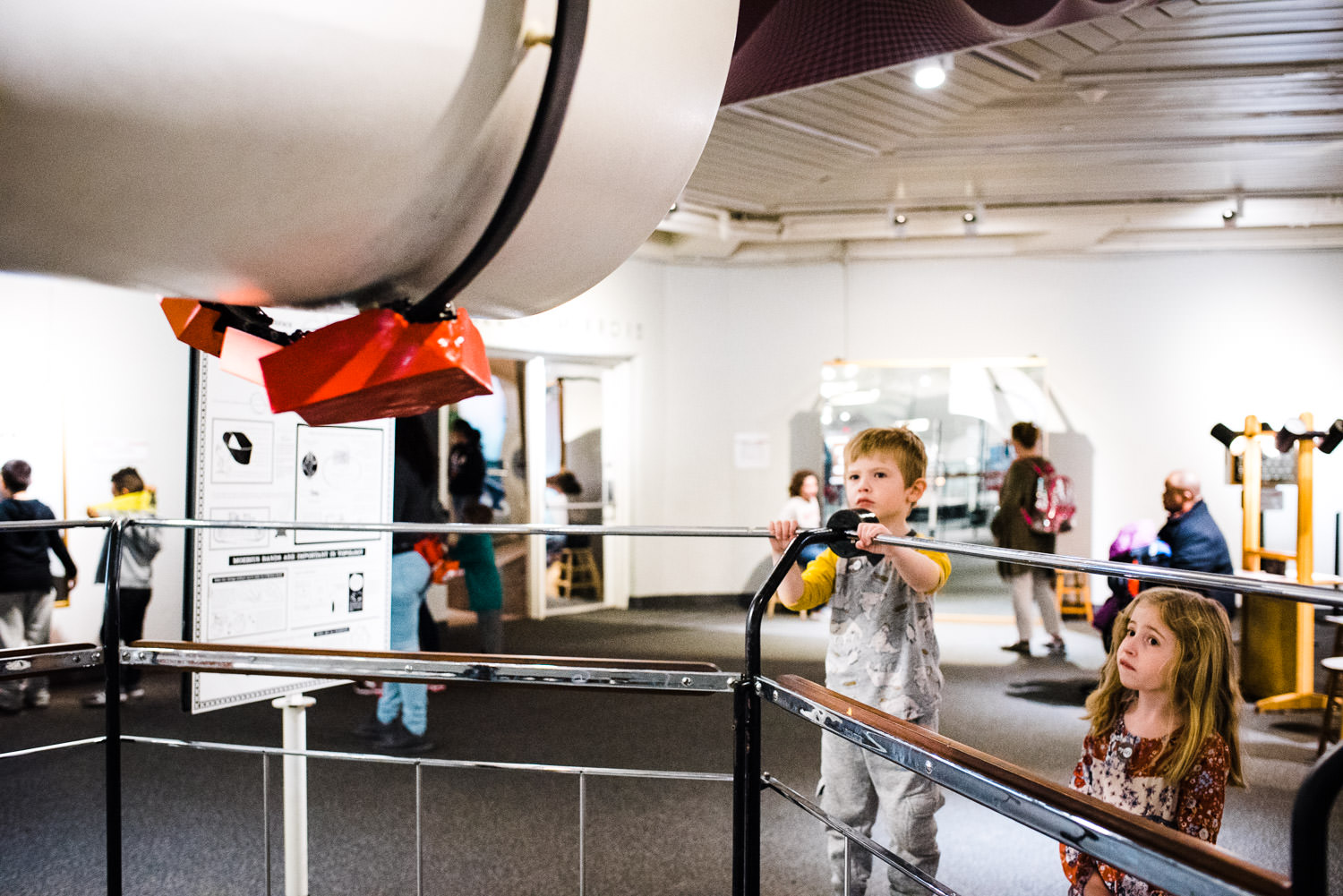 Two children look at an exhibit at the Hall of Science.
