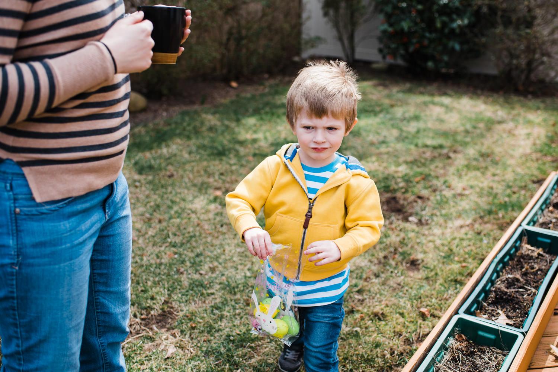 A little boy gathers Easter eggs.