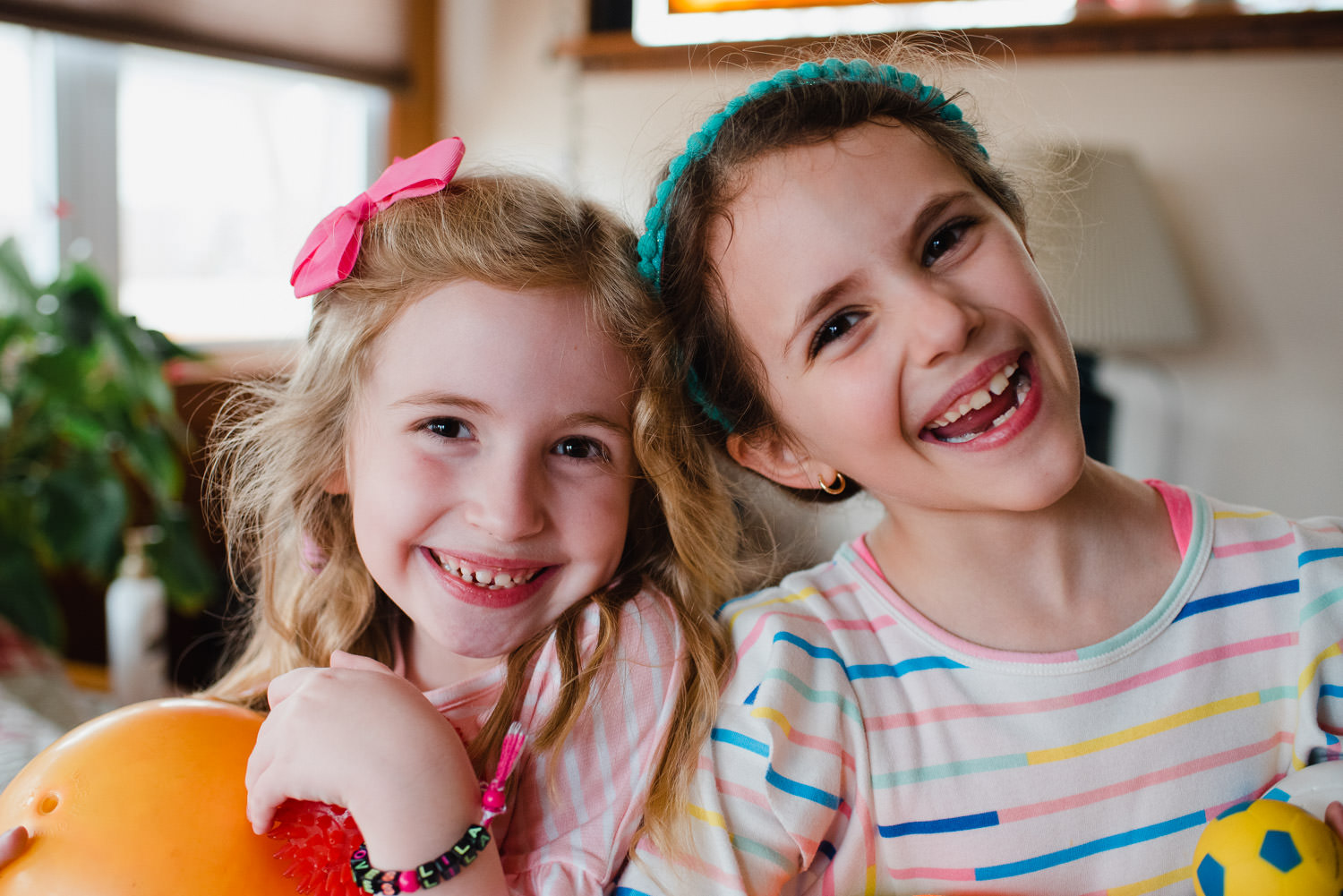 Two little girls smile at the camera.