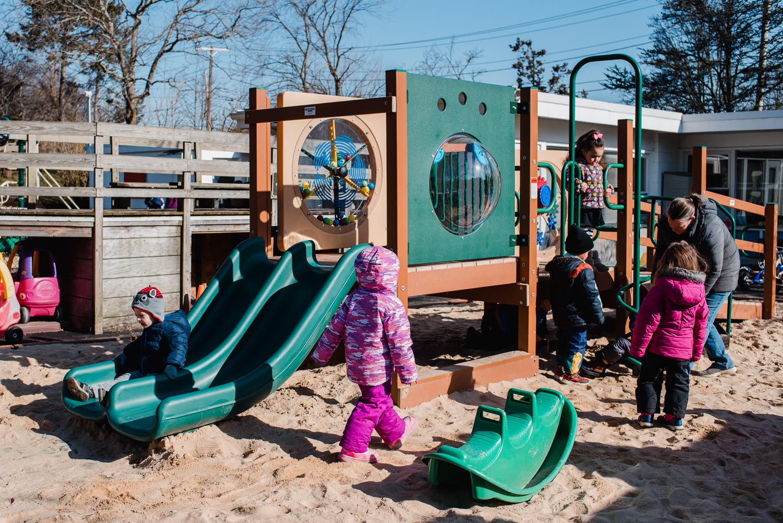 Children play on a nursery school playground.