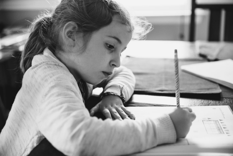 A little girl works on her homework.