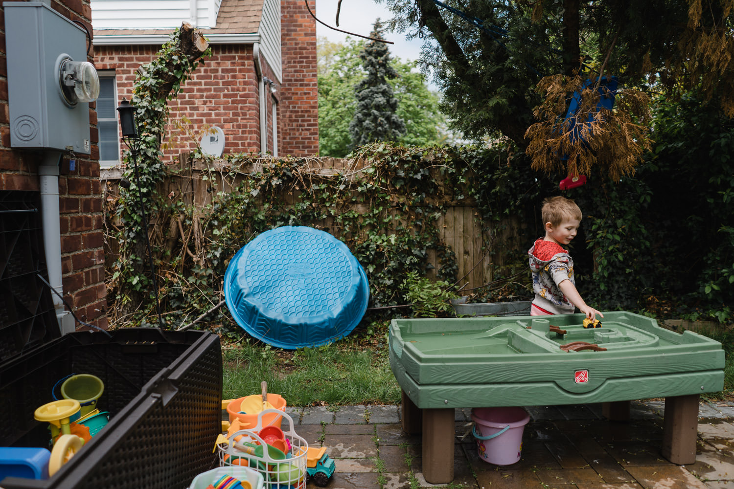 A little boy plays in his backyard.