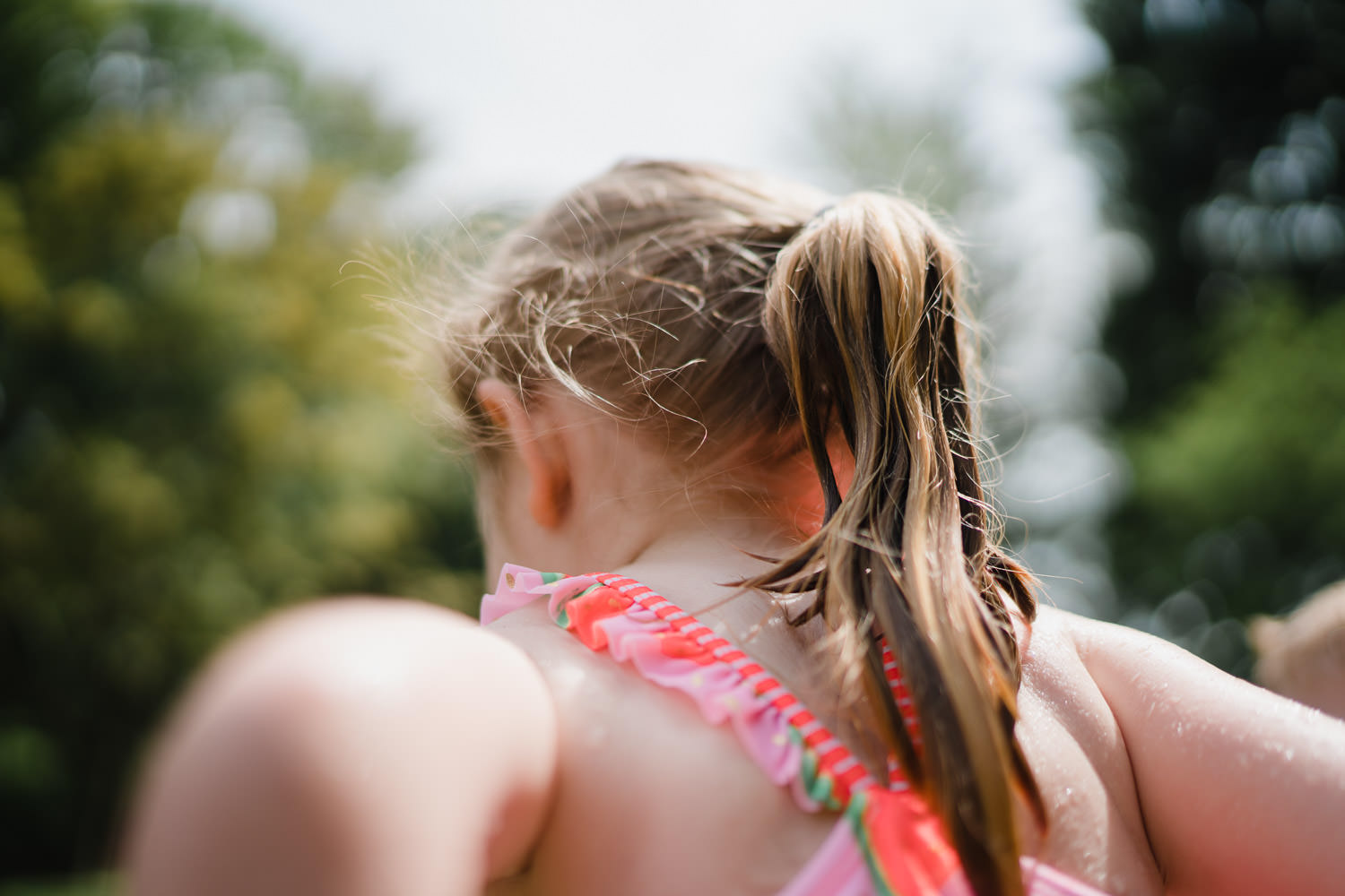 A little girl's wet ponytail.