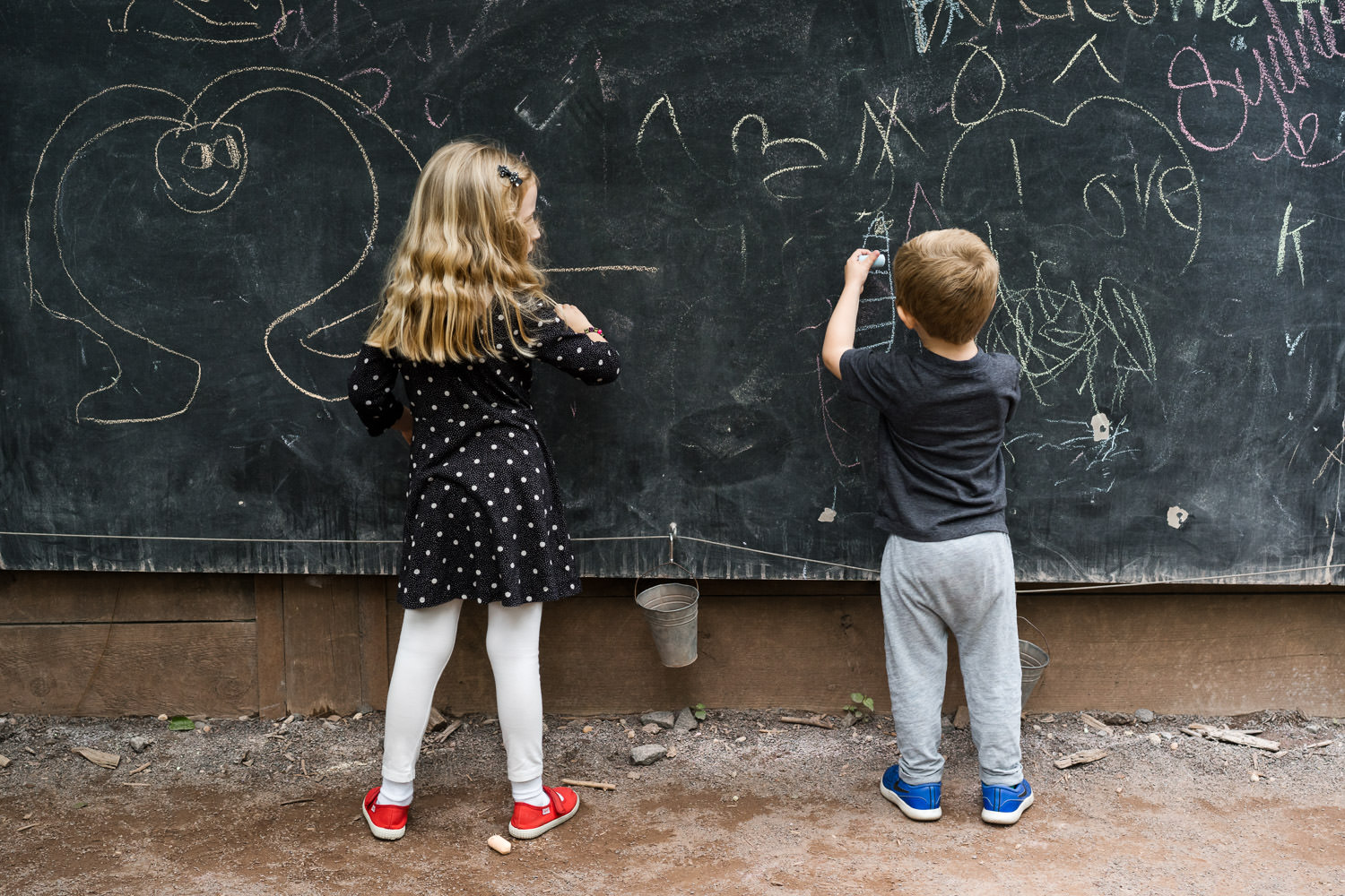 Two children draw with chalk at the Bronx Zoo.