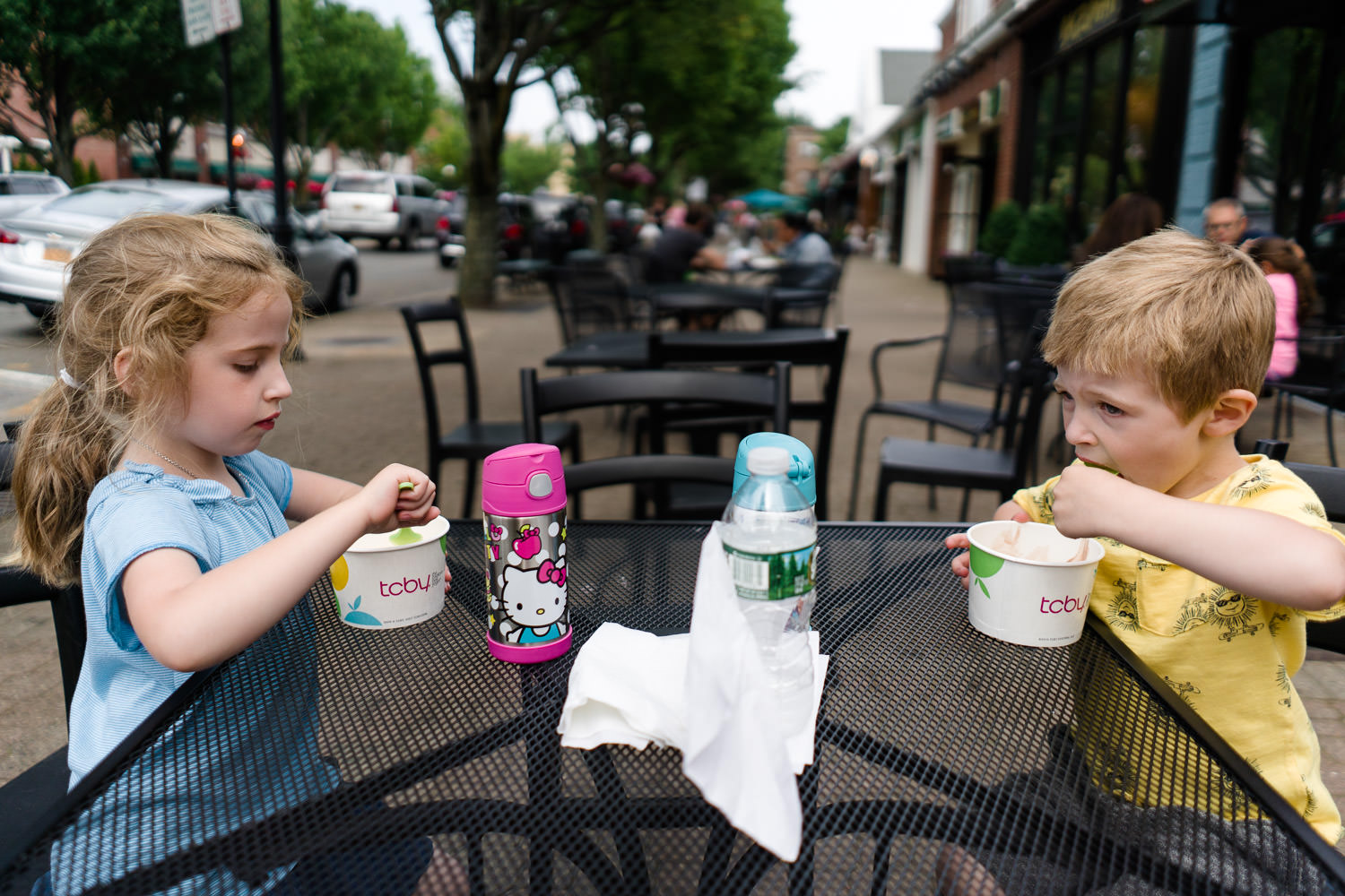 Two children eat frozen yogurt on 7th Street in Garden City.