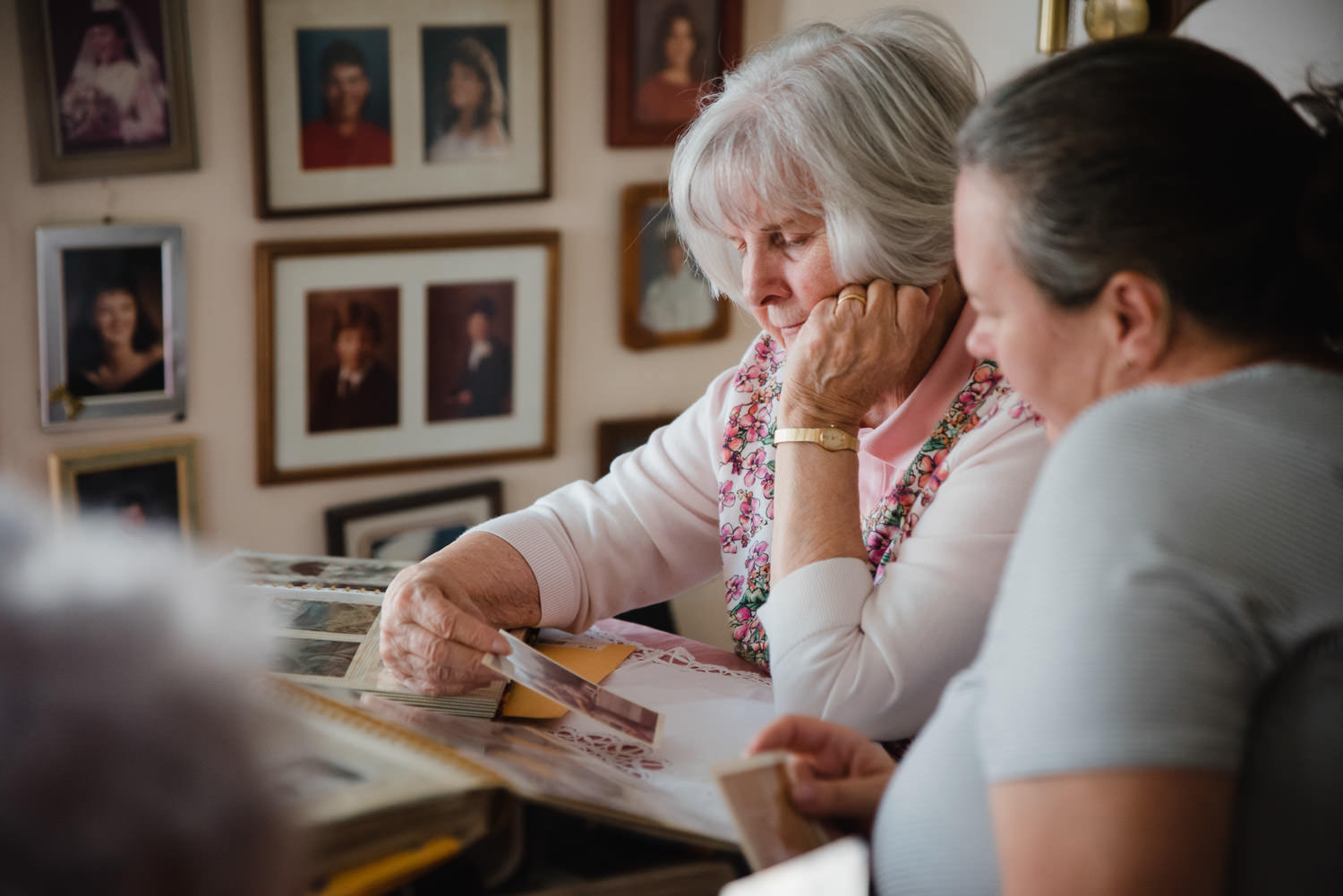 A mother and daughter look through family photographs.
