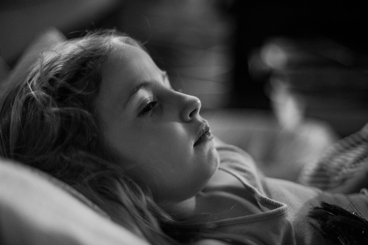 The profile of a little girl lying down.