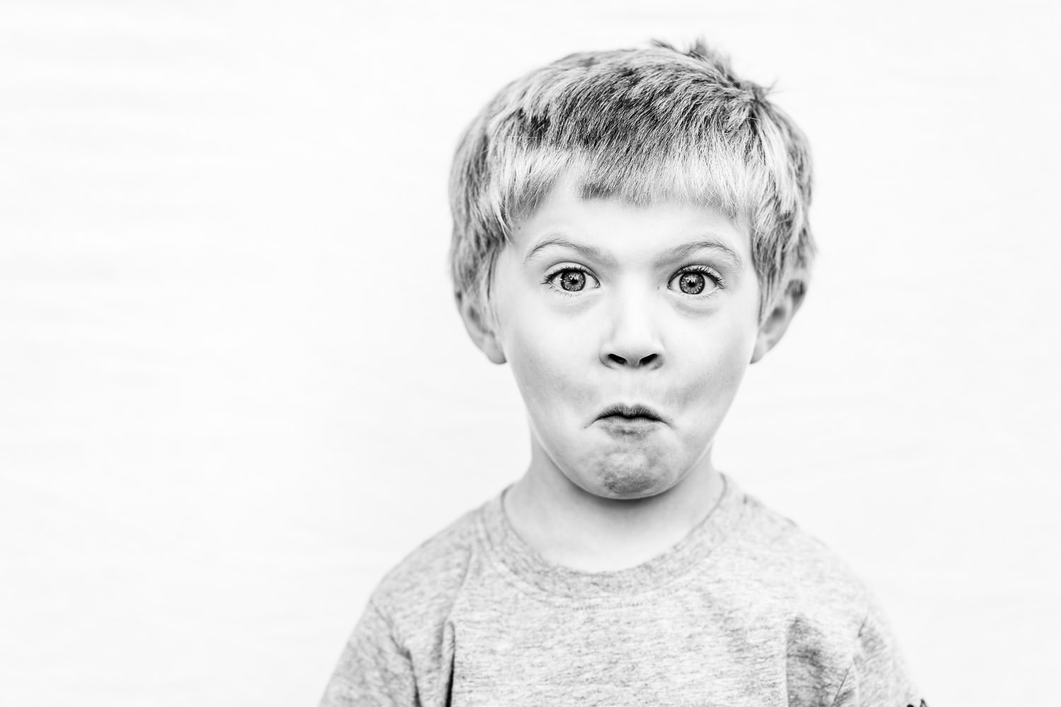 A portrait of a boy with a funny expression.