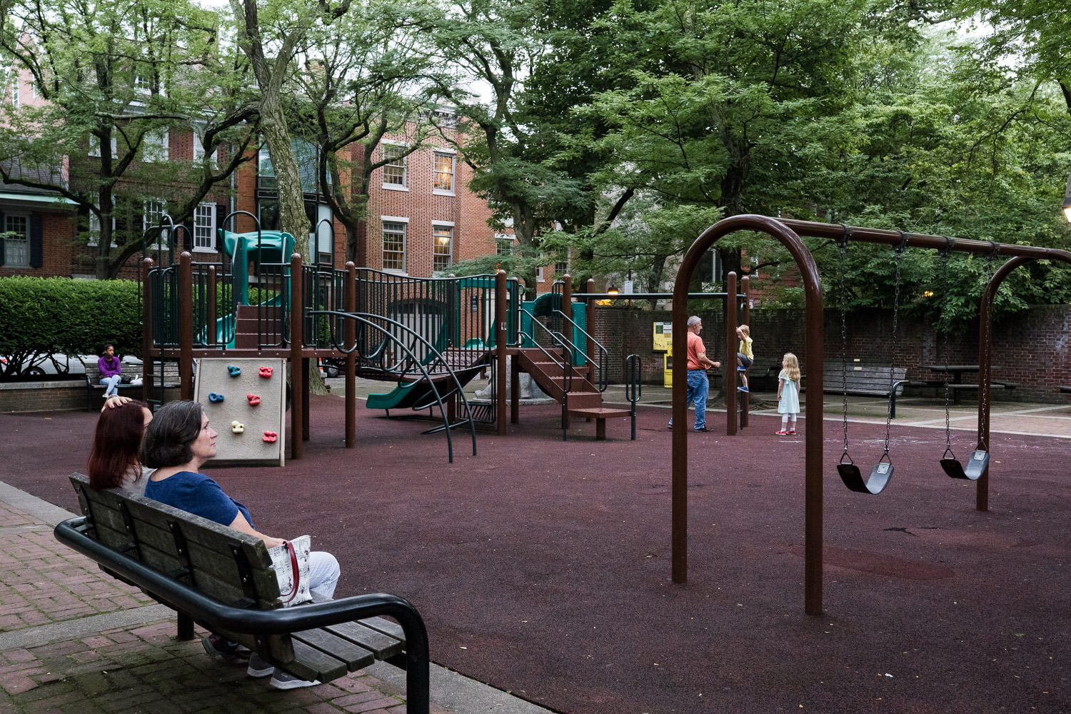 A family plays at a Philadelphia playground.