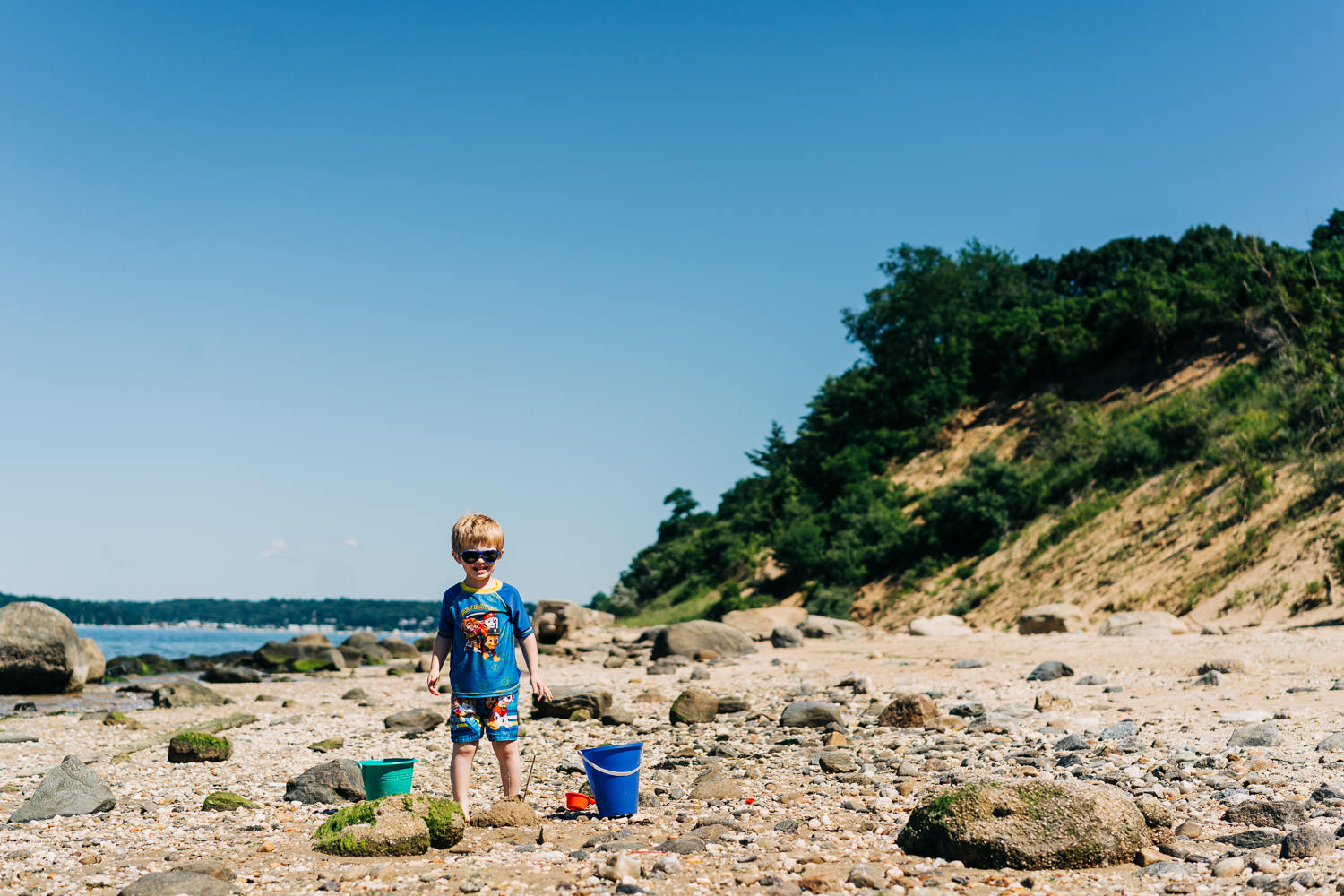A little boy plays on the beach at Sands Point.