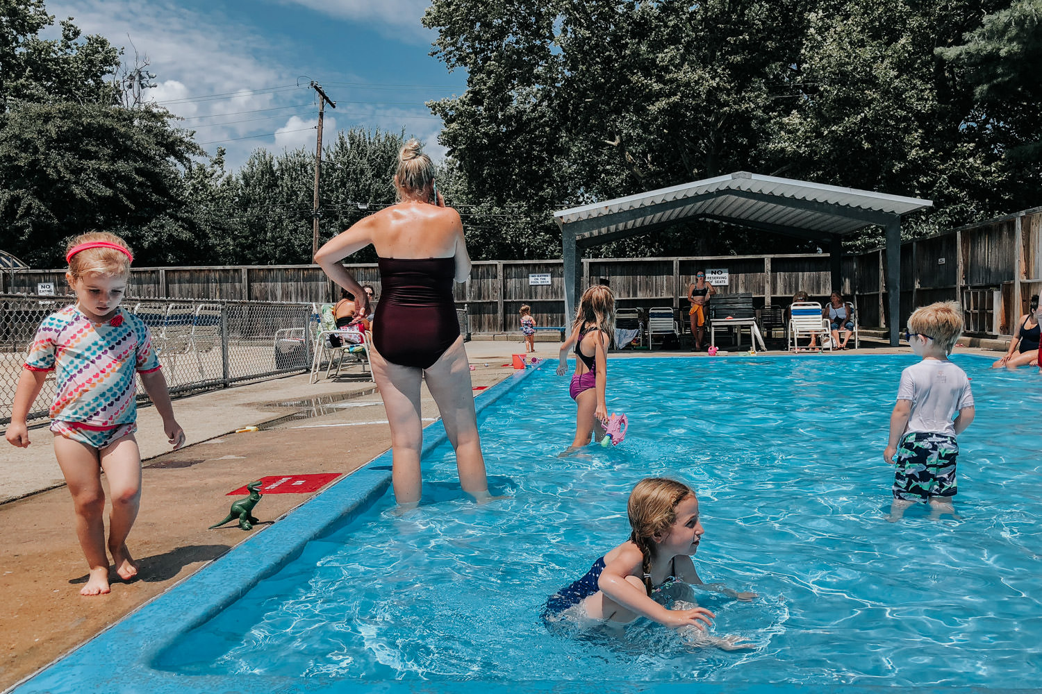 Families play at the town pool.