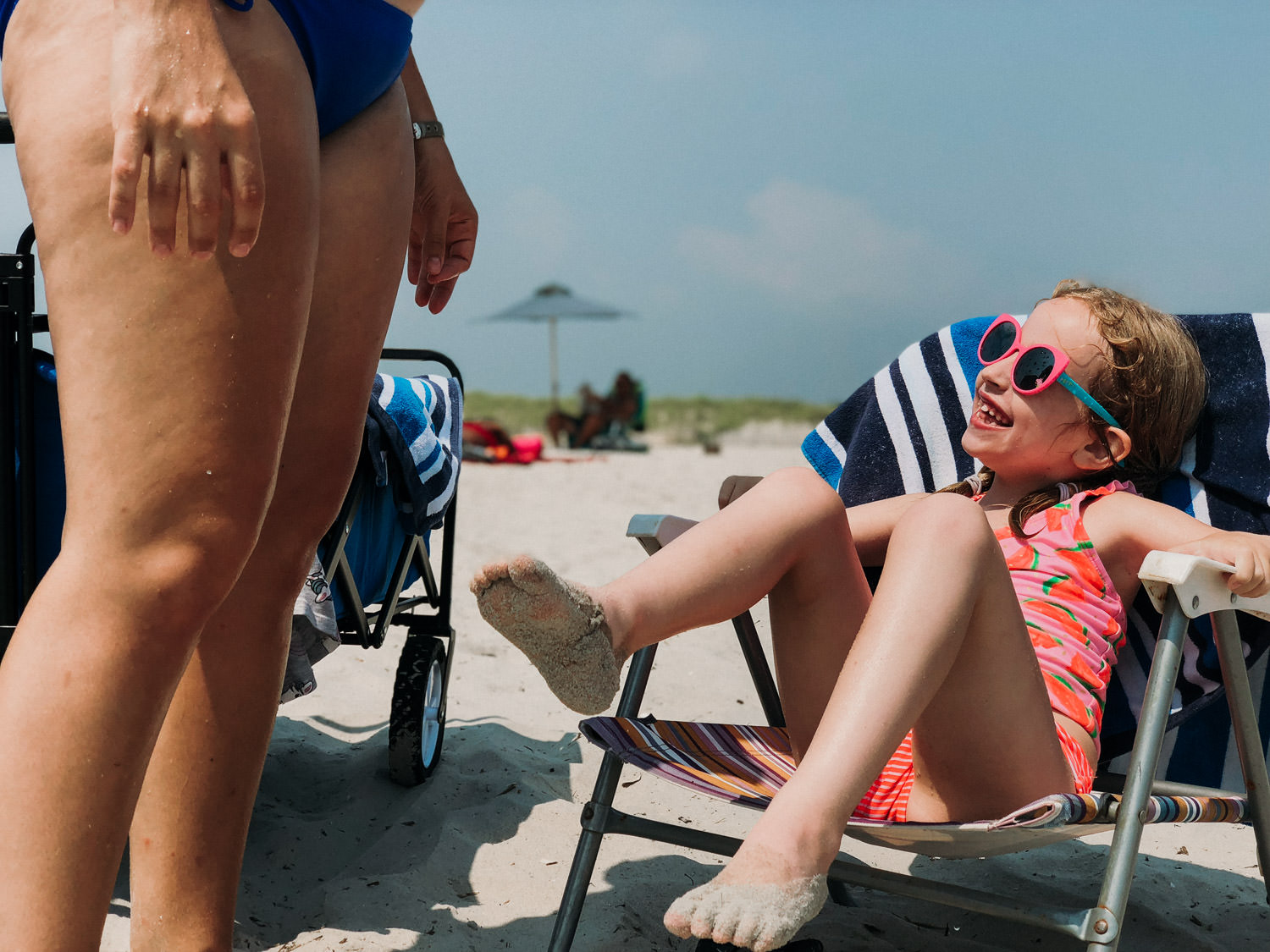 A little girl sits in a beach chair at Lido Beach.