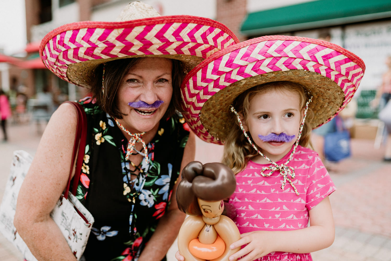 A grandmother and granddaughter wear sombreros at Fiesta Friday on 7th Street.