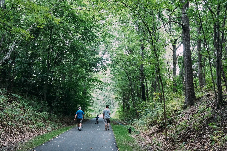 A family walks down a trail.