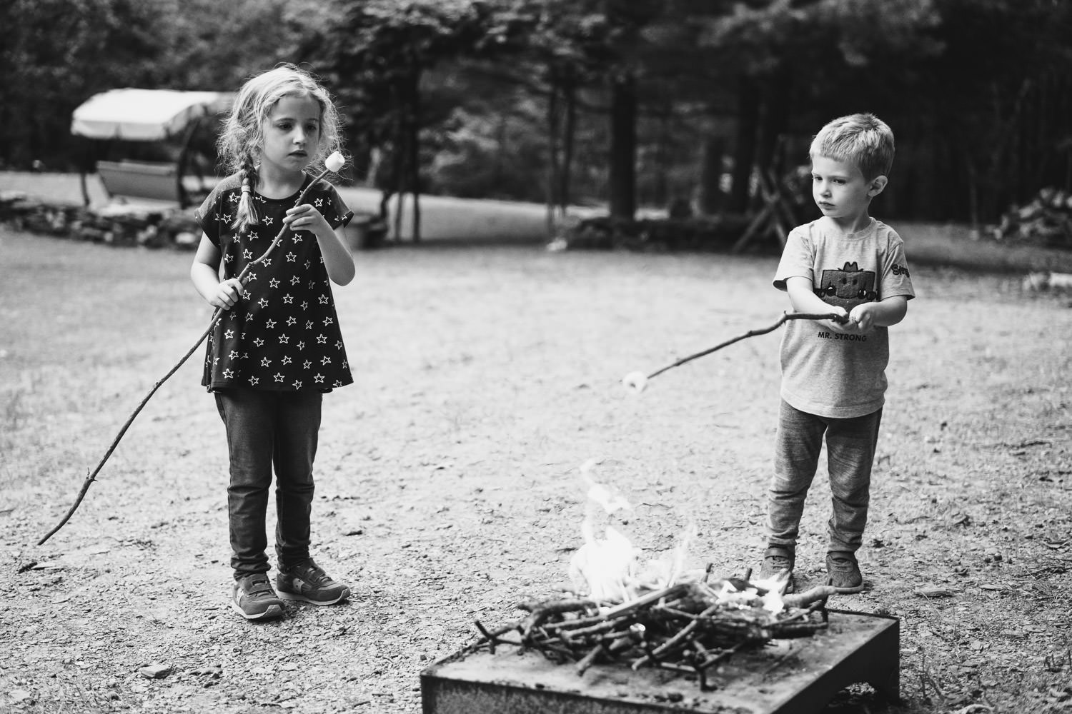 Children make s'mores.