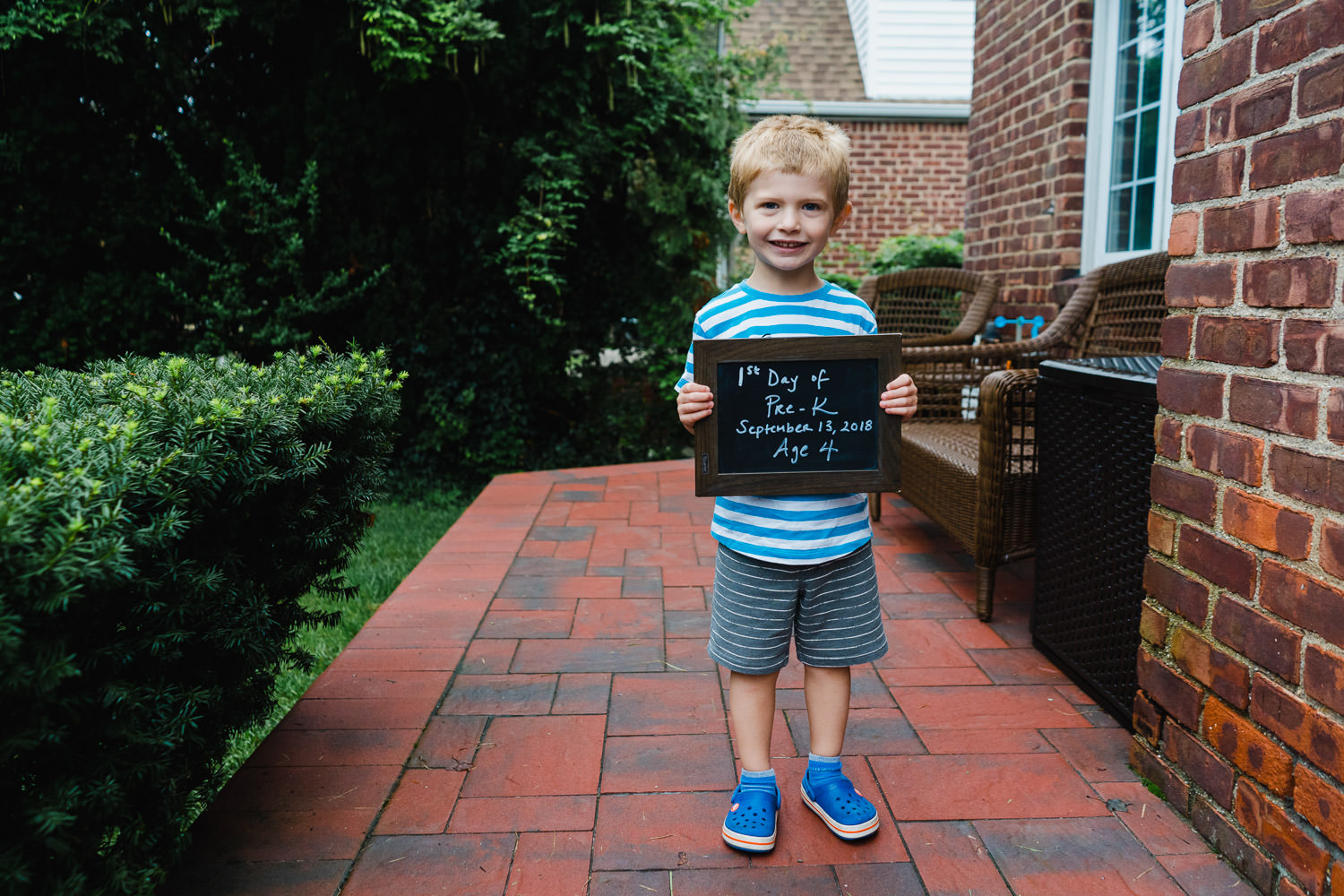 A little boy on the first day of school.