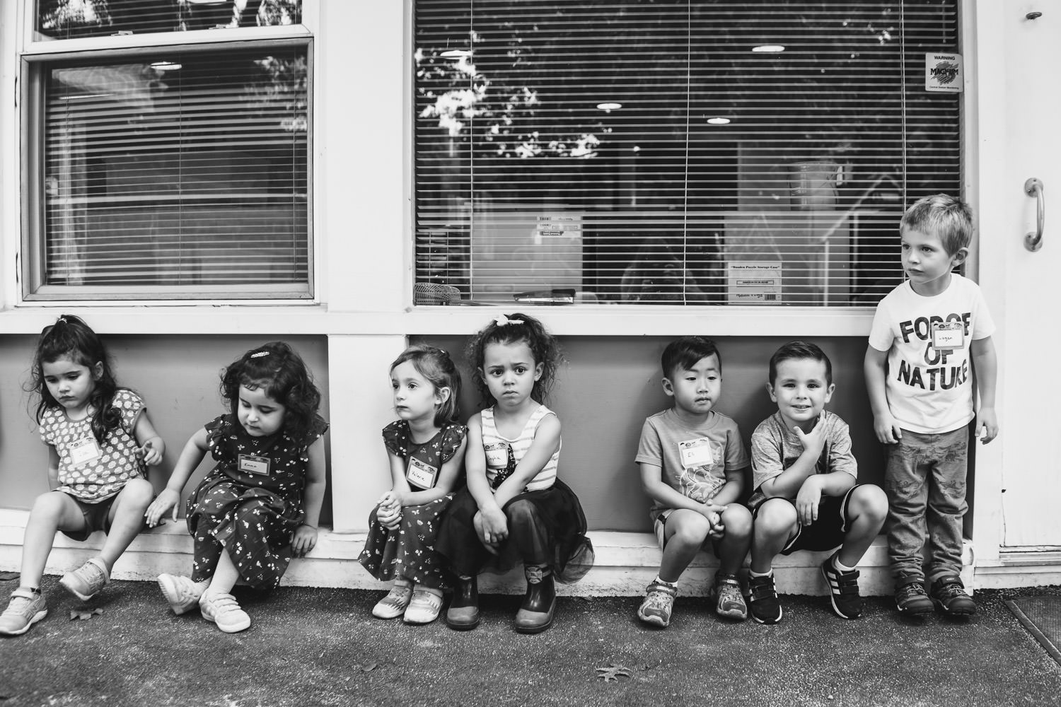 Preschoolers line up outside their classroom.