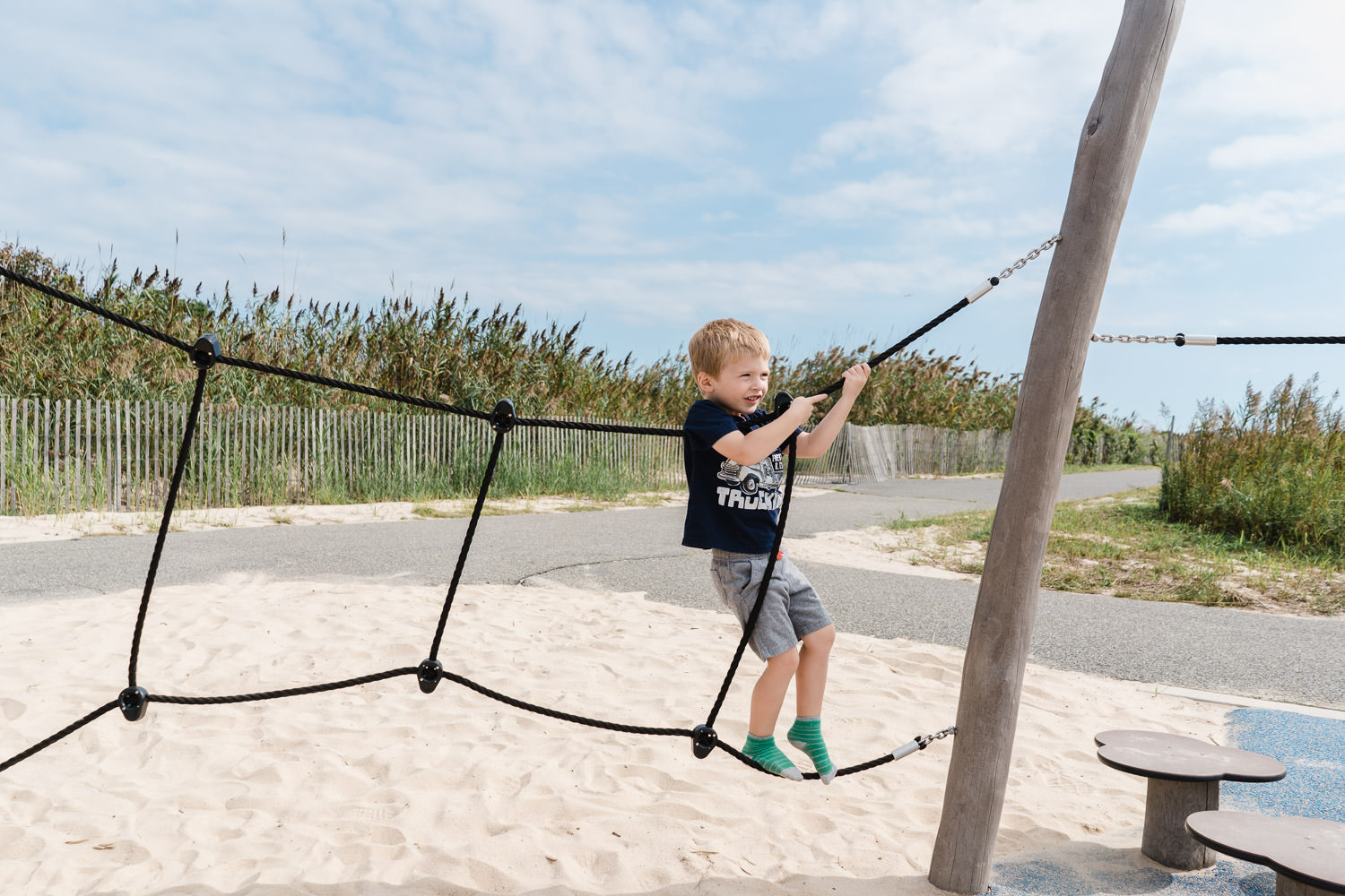 A little boy plays at Captree State Park.