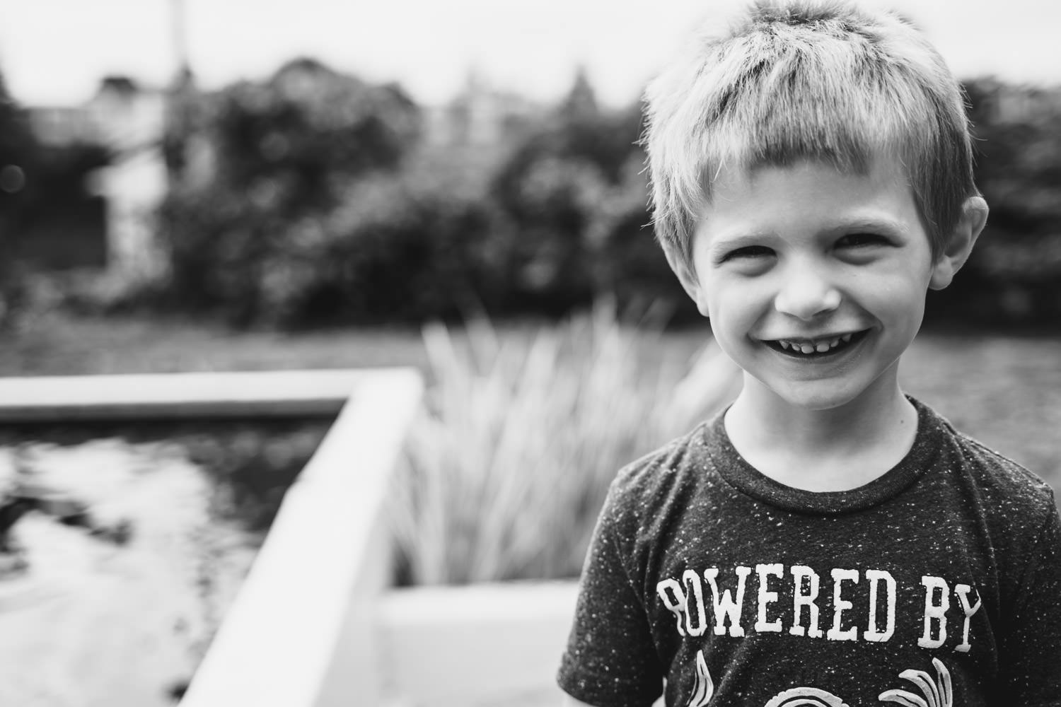 A little boy smiles at the camera.