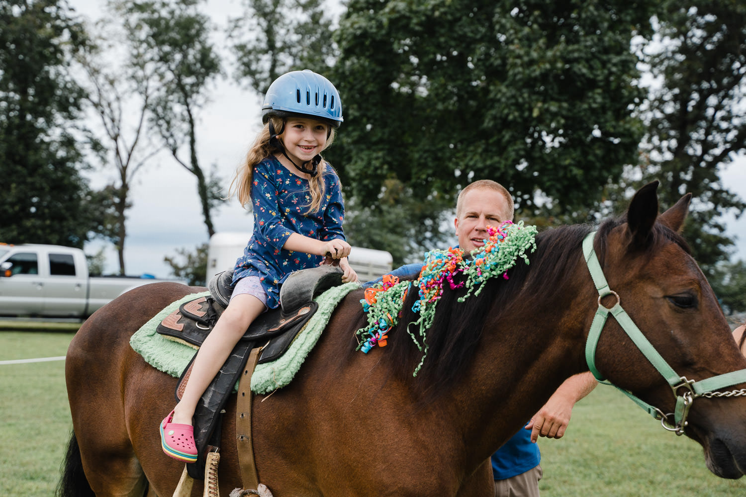 A little girl rides a horse at Sands Point Preserve.