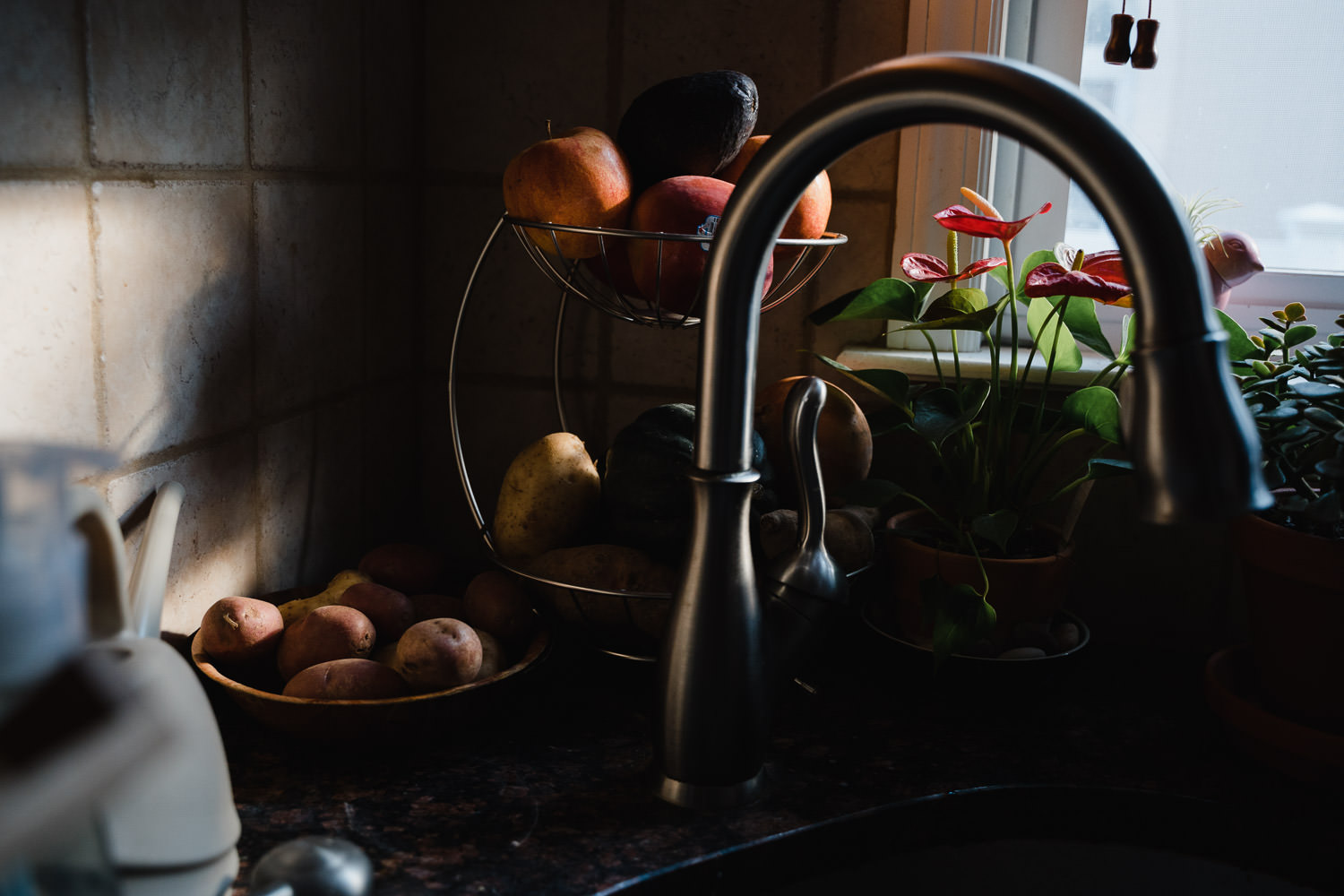 Still life of fruit in a kitchen.