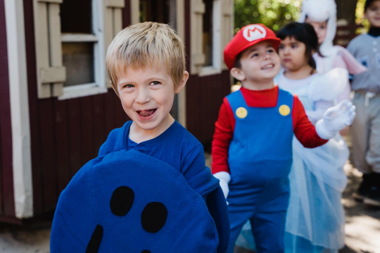 A little boy smiles during his Halloween parade.