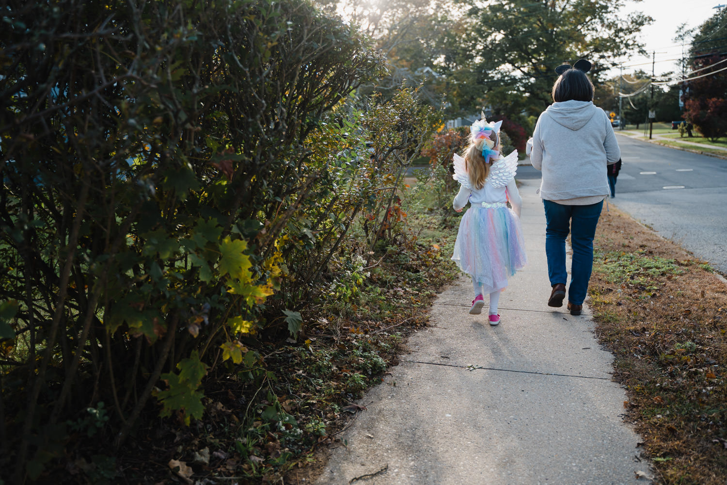 A little girl and her grandmother go trick-or-treating.