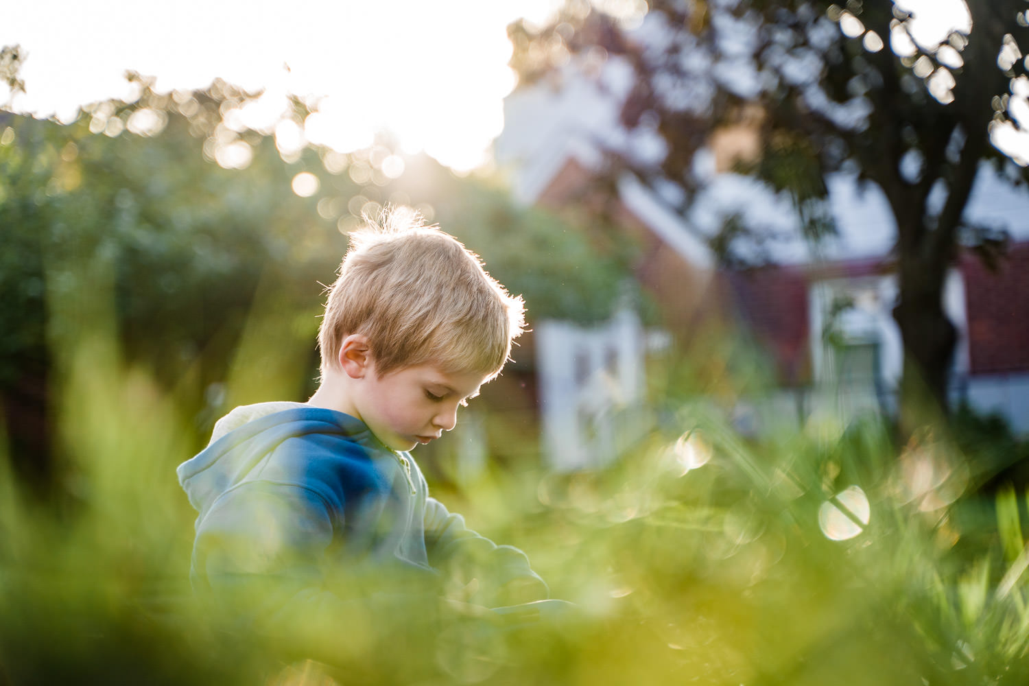 A little boy plays in the grass.