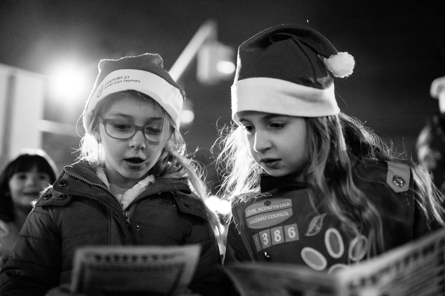 Girl scouts sing carols.